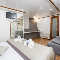 Adriatic Prestige-ship-double-cabin-with-couch-angle-view